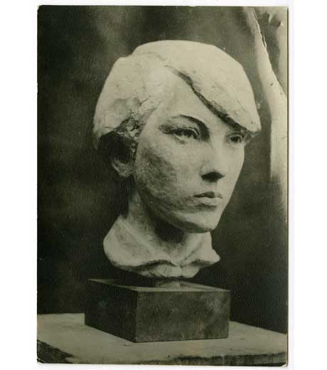 Head of a girl in stone by Jussuf Abbo