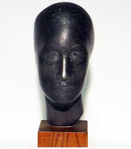 Woman's head in pewter by Jussuf Abbo