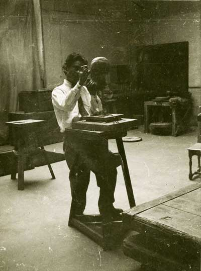 Jussuf Abbo, working on a sculpture.